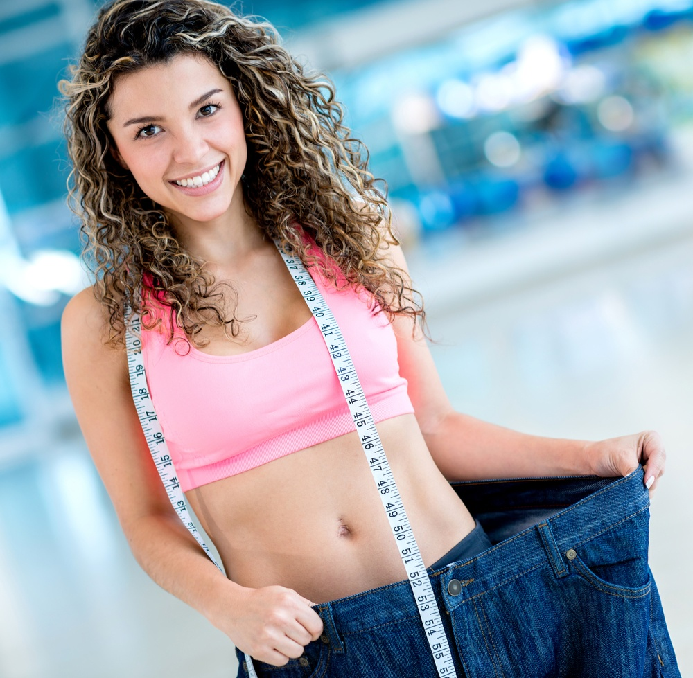 Fit woman in big pants after loosing a lot of weight