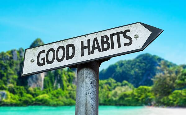 Good Habits sign with a beach on background