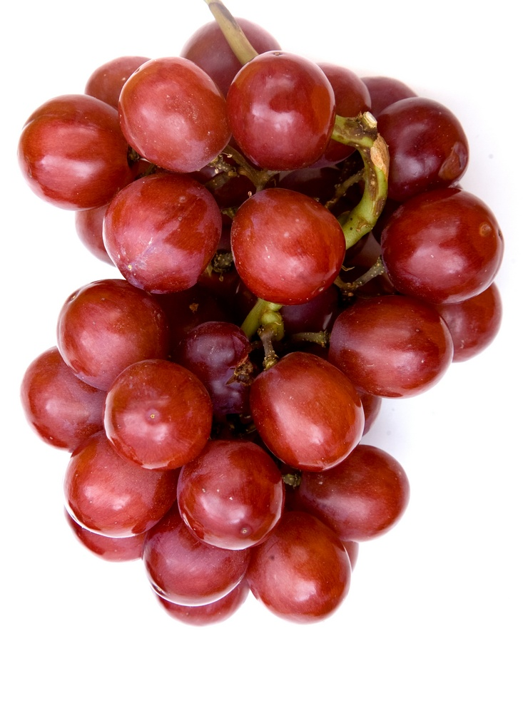 bunch of grapes isolated over a white background
